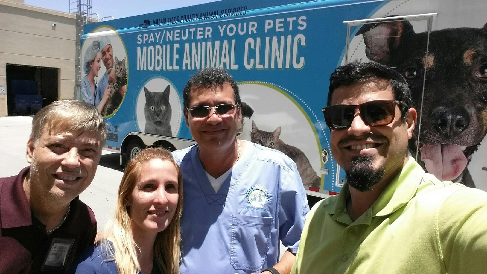 With vet technician staff of Miami Veterinary Foundation